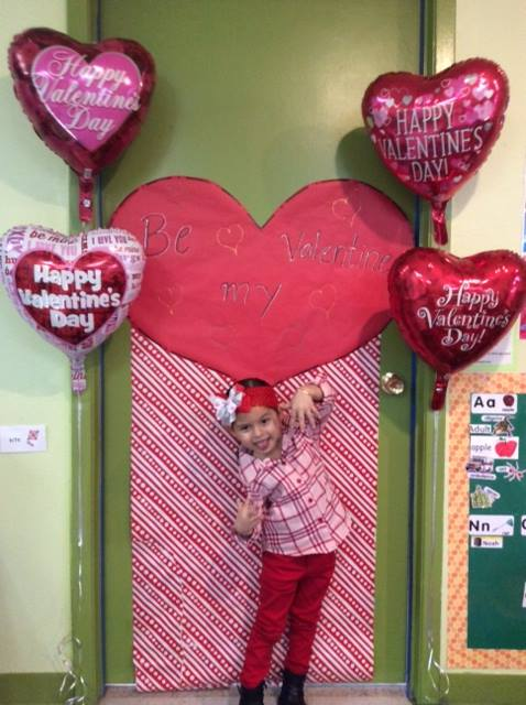 Child in Front of Door with Valentine